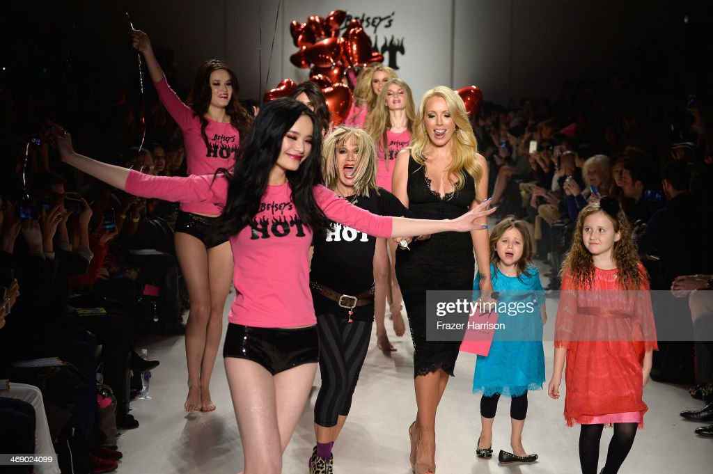 Designer Betsey Johnson walks the runway with her daughter LuLu Johnson and granddaughters Ella and Layla at the Betsey Johnson fashion show during Mercedes-Benz Fashion Week Fall 2014 at The Salon at Lincoln Center on February 12, 2014 in New York City.