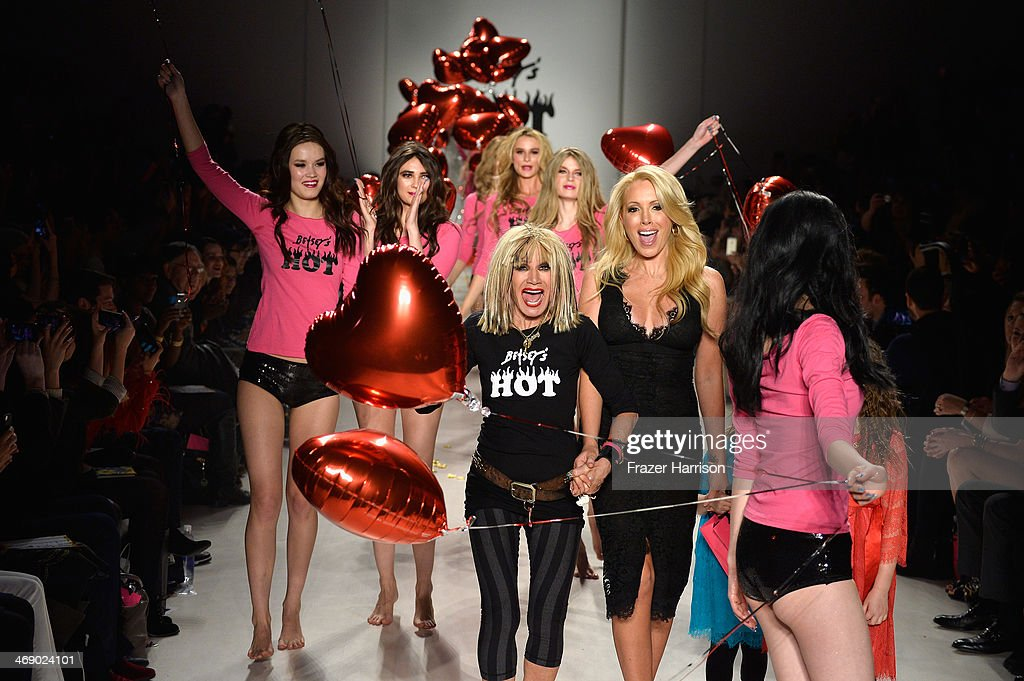 Designer <a gi-track='captionPersonalityLinkClicked' href=/galleries/search?phrase=Betsey+Johnson+-+Fashion+Designer&family=editorial&specificpeople=4205426 ng-click='$event.stopPropagation()'>Betsey Johnson</a> walks the runway with her daughter LuLu Johnson and granddaughters Ella and Layla at the <a gi-track='captionPersonalityLinkClicked' href=/galleries/search?phrase=Betsey+Johnson+-+Fashion+Designer&family=editorial&specificpeople=4205426 ng-click='$event.stopPropagation()'>Betsey Johnson</a> fashion show during Mercedes-Benz Fashion Week Fall 2014 at The Salon at Lincoln Center on February 12, 2014 in New York City.