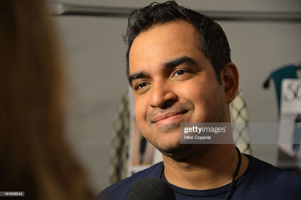 Designer Bibhu Mohapatra prepares backstage at the Bibhu Mohapatra Fall 2013 fashion show during Mercedes-Benz Fashion Week at The Studio at Lincoln Center on February 13, 2013 in New York City.