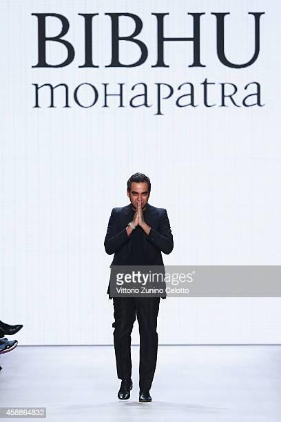 Designer Bibhu Mohapatra walks the runway after his show during the MercedesBenz Fashion Days Zurich 2014 on November 12 2014 in Zurich Switzerland