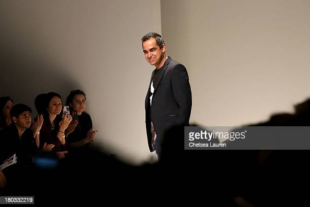 Designer Bibhu Mohapatra walks the runway at the Bibhu Mohapatra fashion show during MercedesBenz Fashion Week Spring 2014 at The Studio at Lincoln...