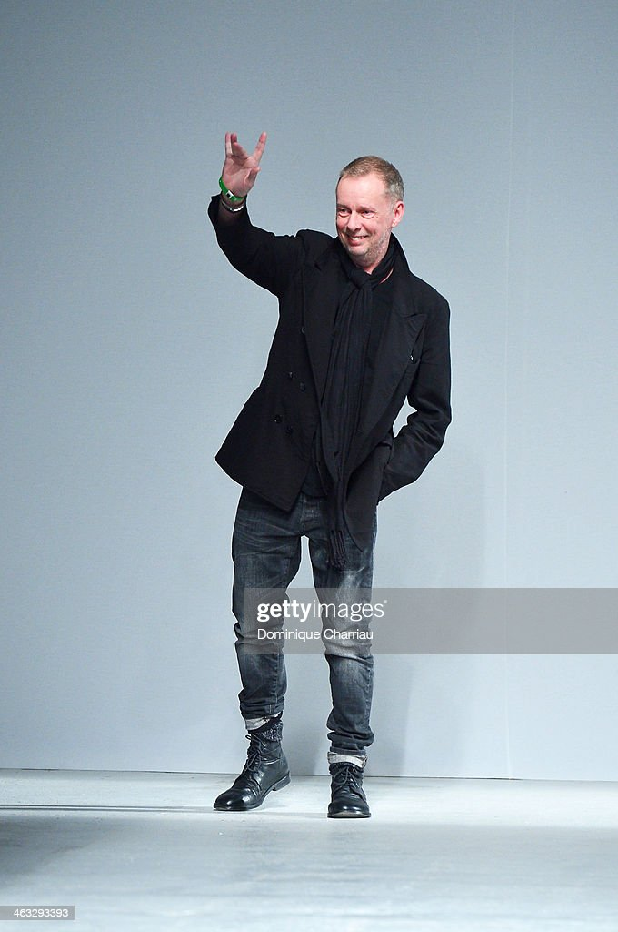 Designer Bill Gaytten acknowledges the applause of the audience at the end of the John Galliano Menswear Fall/Winter 20142015 show as part of Paris...