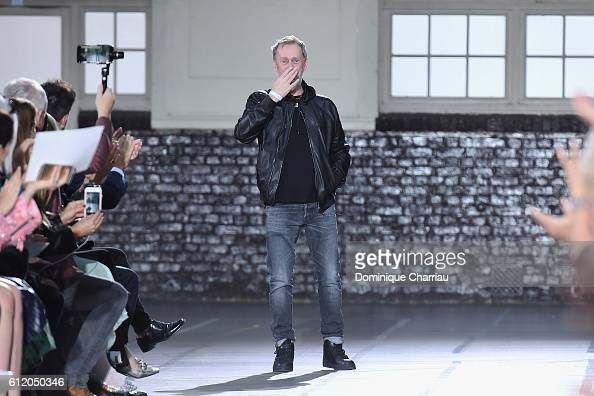 Designer Bill Gaytten walks the runway during the John Galliano show as part of the Paris Fashion Week Womenswear Spring/Summer 2017 on October 2...