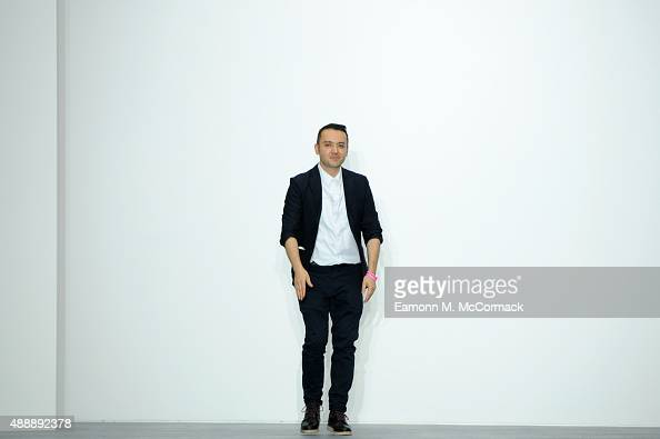 Designer Bora Aksu appears at the end of the runway following the Bora Aksu show during London Fashion Week Spring/Summer 2016 on September 18 2015...