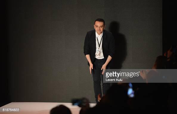 Designer Bora Aksu attends his runway show during the MercedesBenz Fashion Week Istanbul Autumn/Winter 2016 at Zorlu Center on March 15 2016 in...