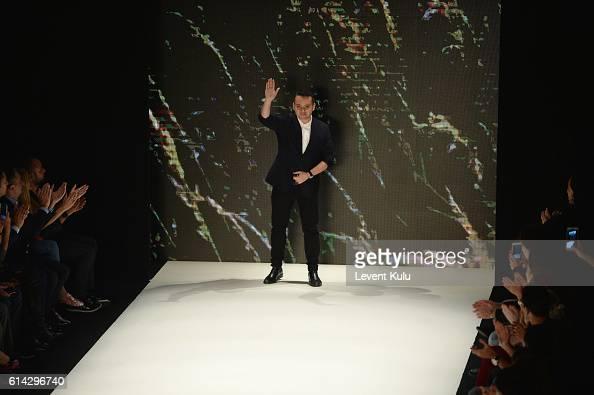 Designer Bora Aksu walks the runway at the Bora Aksu show during MercedesBenz Fashion Week Istanbul at Zorlu Center on October 13 2016 in Istanbul...