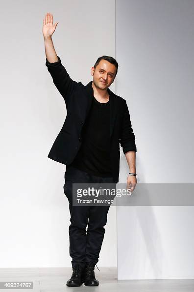 Designer Bora Aksu waves to crowd on the runway at the Bora Aksu show at London Fashion Week AW14 at Somerset House on February 14 2014 in London...