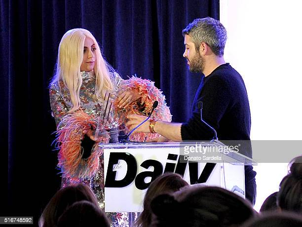 COVERAGE Designer Brandon Maxwell accepts Best Designer Debut award from singer/actress Lady Gaga onstage during The Daily Front Row 'Fashion Los...