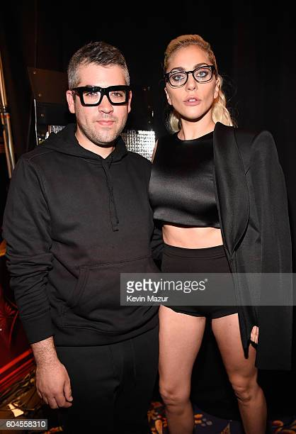 Designer Brandon Maxwell and Lady Gaga pose backstage before Brandon Maxwell's show during New York Fashion Week at Russian Tea Room on September 13...