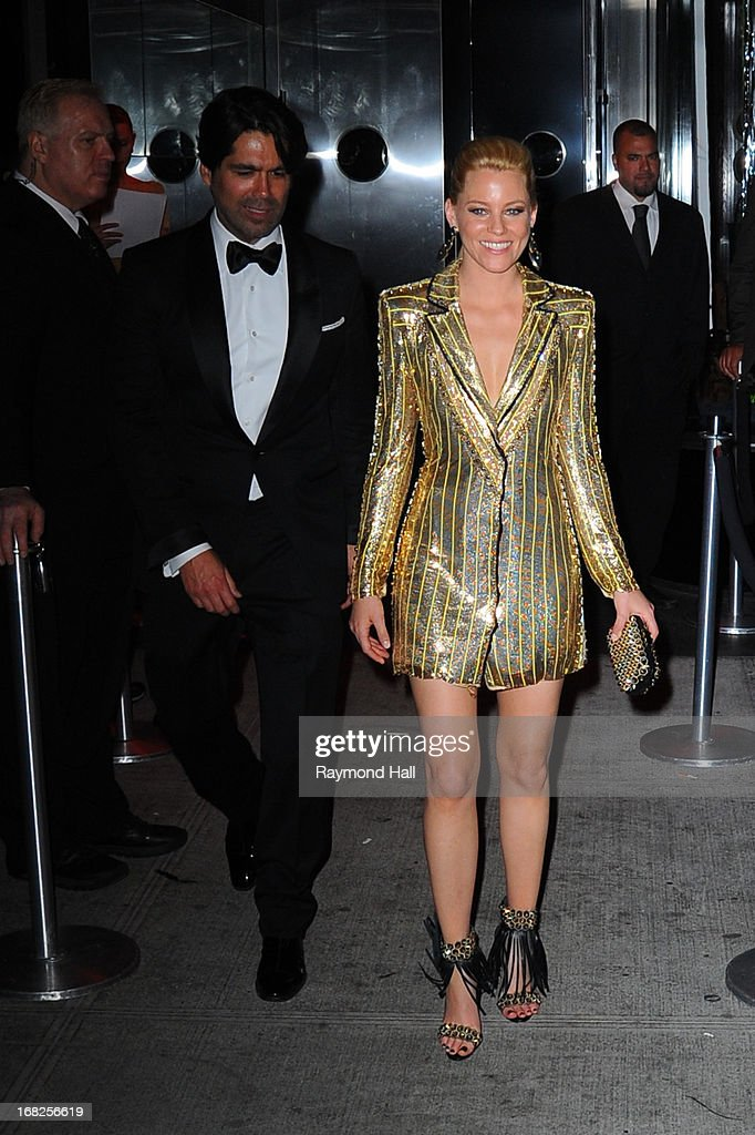 Designer Brian Atwood (L) and actress Elizabeth Banks leaves the 'PUNK: Chaos To Couture' Costume Institute Gala after party at the Standard Hotel on May 6, 2013 in New York City.