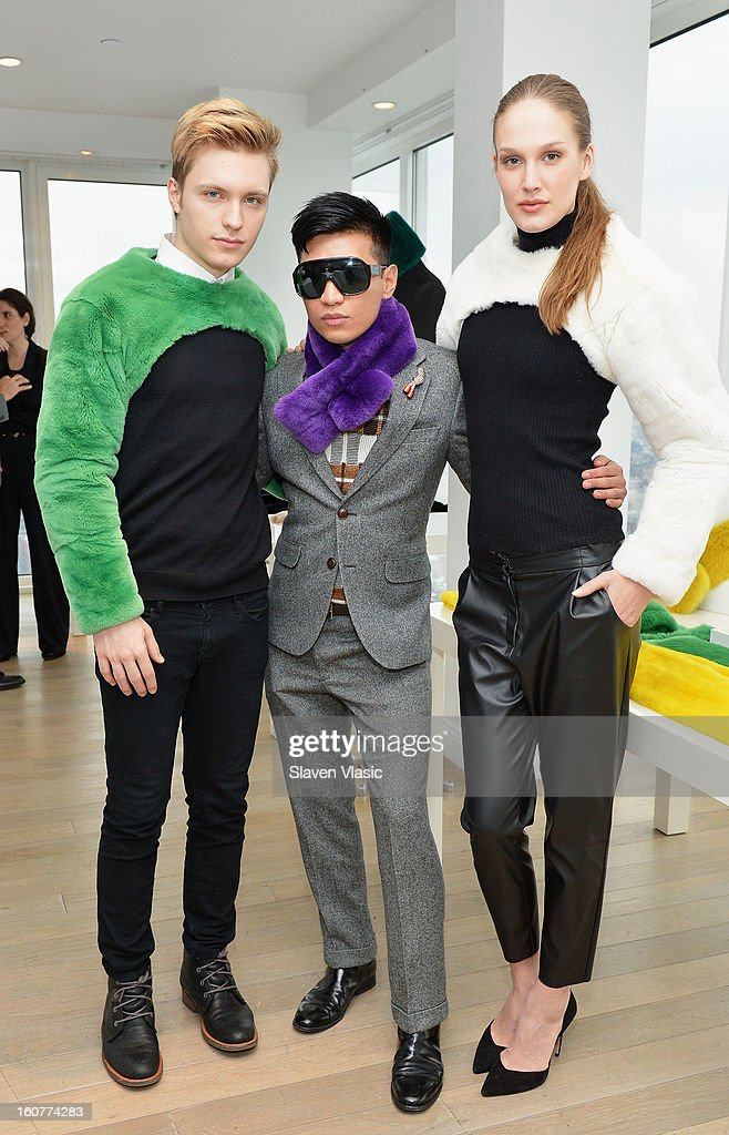 Designer Bryan Boy (C) and models pose for photo at Bryan Boy For Adrienne Landau Presentation - Fall 2013 Mercedes-Benz Fashion Week at Mondrian SoHo on February 5, 2013 in New York City.