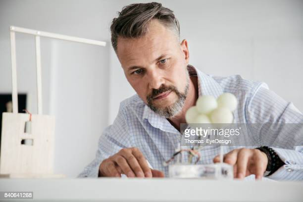 Designer Building Mockup At His Desk