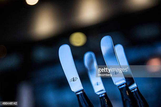Designer butter knives sit on display in the gift shop at Forge De Laguiole traditional knife and cutlery factory in Laguiole France on Monday Nov 2...