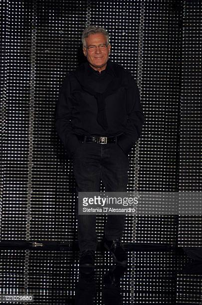 Designer Carlo Pignatelli acknowledges the applause of the audience after the Carlo Pignatelli Outside show as part of Milan Fashion Week...