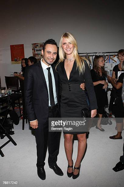 Designer Carlos Campos and America's Next Top Model winner CariDee English pose for a picture backstage at the Carlos Campos Fashion Show Starlight...