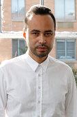 Designer Carlos Campos poses at the Carlos Campos presentation during New York Men's Day at Industria Studios on September 3 2014 in New York City