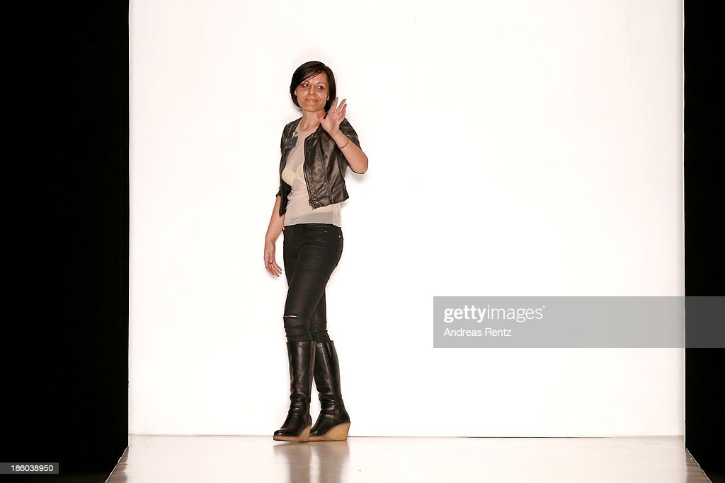 Designer Carmen Emanuela acknowledges the applause of the audience after the Carmen Emanuela Popa show during Mercedes-Benz Fashion Week Russia S/S 2014on October 27, 2013 in Moscow, Russia.