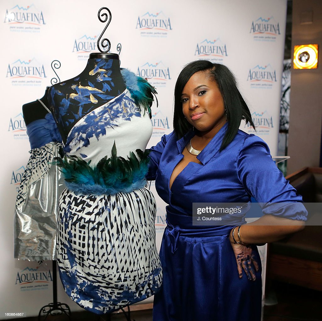 Designer Carmen Green of Baltimore, MD poses in front of her winning design after winning The Aquafina 'Pure Challenge' at the Aquafina 'Pure Challenge' After Party at The Empire Hotel Rooftop on February 6, 2013 in New York City.