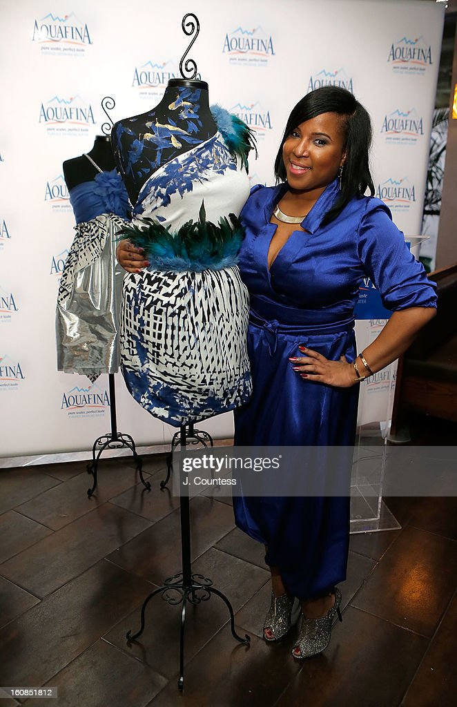 Designer Carmen Green of Baltimore, MD poses with her winning design duringThe Aquafina 'Pure Challenge' at the Aquafina 'Pure Challenge' After Party at The Empire Hotel Rooftop on February 6, 2013 in New York City.