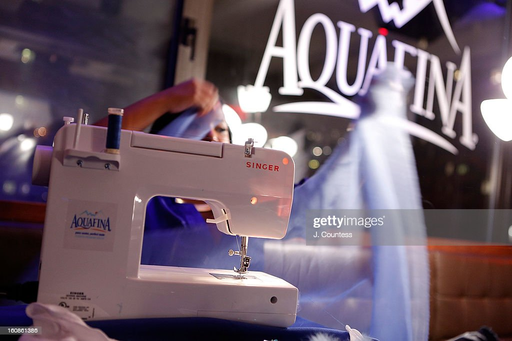 Designer Carmen Green works on her design during the Aquafina 'Pure Challenge' at the Aquafina 'Pure Challenge' After Party at The Empire Hotel Rooftop on February 6, 2013 in New York City.