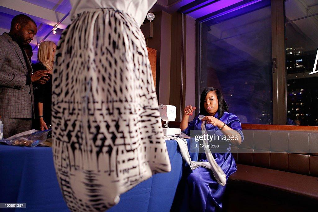 Designer Carmen Green works on her design during the Aquafina 'Pure Challenge' at the Aquafina 'Pure Challenge' After Party at The Empire Hotel Rooftop on February 6, 2013 in New York City.