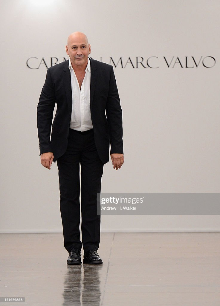 Designer Carmen Marc Valvo walks the runway at the Carmen Marc Valvo Spring 2013 fashion show during Mercedes-Benz Fashion Week at 575 7th Avenue on September 9, 2012 in New York City.
