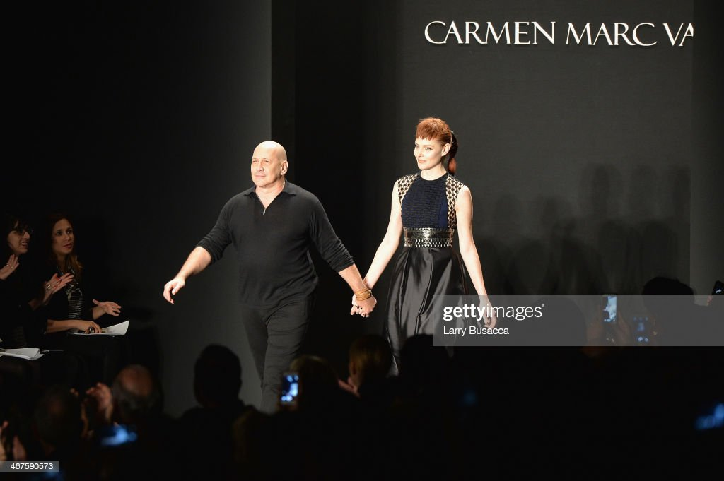 Designer <a gi-track='captionPersonalityLinkClicked' href=/galleries/search?phrase=Carmen+Marc+Valvo+-+Fashion+Designer&family=editorial&specificpeople=8227893 ng-click='$event.stopPropagation()'>Carmen Marc Valvo</a> (L) walks the runway at the <a gi-track='captionPersonalityLinkClicked' href=/galleries/search?phrase=Carmen+Marc+Valvo+-+Fashion+Designer&family=editorial&specificpeople=8227893 ng-click='$event.stopPropagation()'>Carmen Marc Valvo</a> fashion show during Mercedes-Benz Fashion Week Fall 2014 at The Salon at Lincoln Center on February 7, 2014 in New York City.