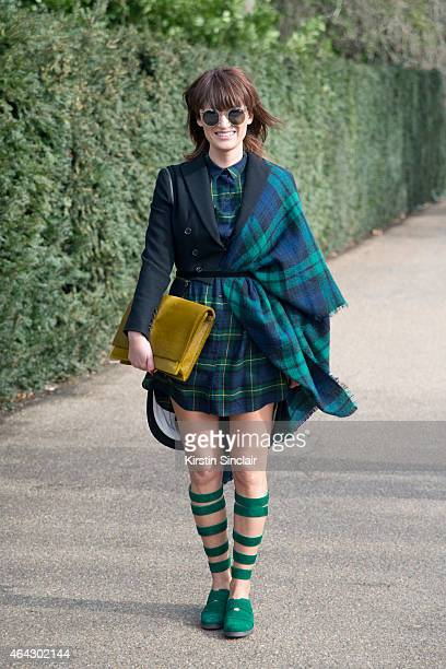 Designer Carmen Negoita wears Quay sunglasses Yvy bag Carmen Negoita shoes Alexander McQueen jacket and Zara dress and scarf on February 23 2015 in...