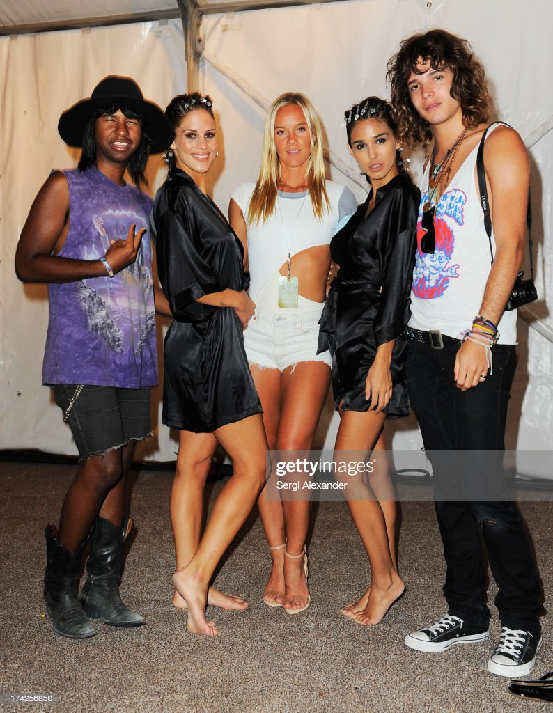 Designer Cassandra Kellogg (C), is seen backstage with Prince Chenoa (L), Jacob Bekat (R) and models at the Minimale Animale show during Mercedes-Benz Fashion Week Swim 2014 at Oasis at the Raleigh Hotel on July 22, 2013 in Miami, Florida.