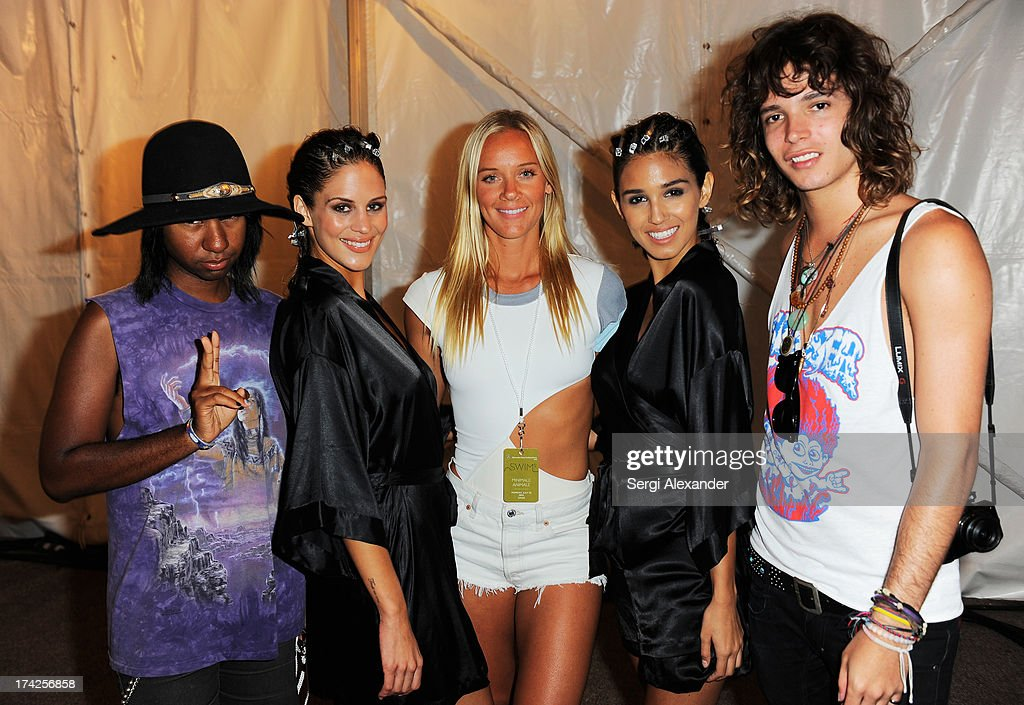 Designer Cassandra Kellogg (C) is seen backstage with Prince Chenoa (L), Jacob Bekat (R) and models at the Minimale Animale show during Mercedes-Benz Fashion Week Swim 2014 at Oasis at the Raleigh Hotel on July 22, 2013 in Miami, Florida.