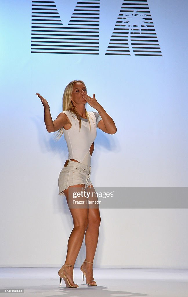 Designer Cassandra Kellogg walks the runway at the Minimale Animale show during Mercedes-Benz Fashion Week Swim 2014 at Oasis at the Raleigh on July 22, 2013 in Miami, Florida.