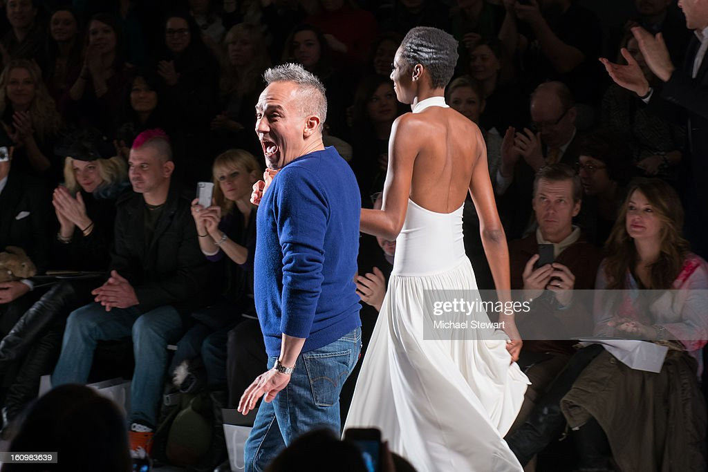 Designer Cesar Galindo (R) and a model walk the runway during CZAR By Cesar Galindo during Fall 2013 Mercedes-Benz Fashion Week at The Studio at Lincoln Center on February 8, 2013 in New York City.
