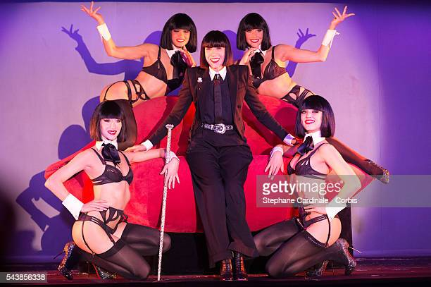Designer Chantal Thomass poses with Crazy Horse's dancers after the Press Conference at Le Crazy Horse on June 30 2016 in Paris France