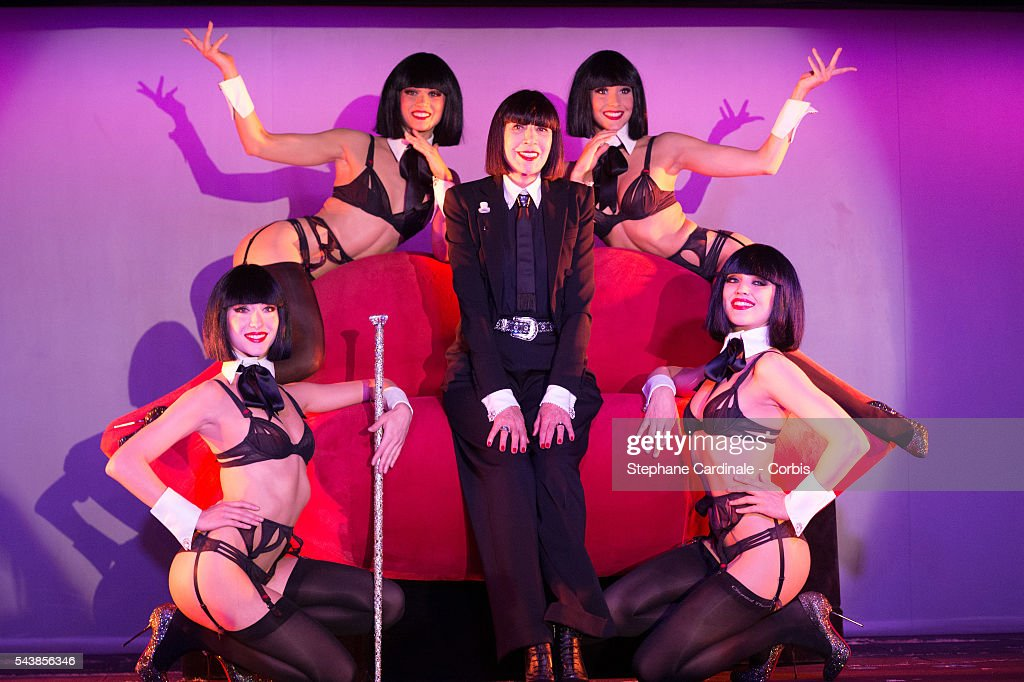 Designer Chantal Thomass poses with Crazy Horse's dancers after the Press Conference at Le Crazy Horse on June 30, 2016 in Paris, France.