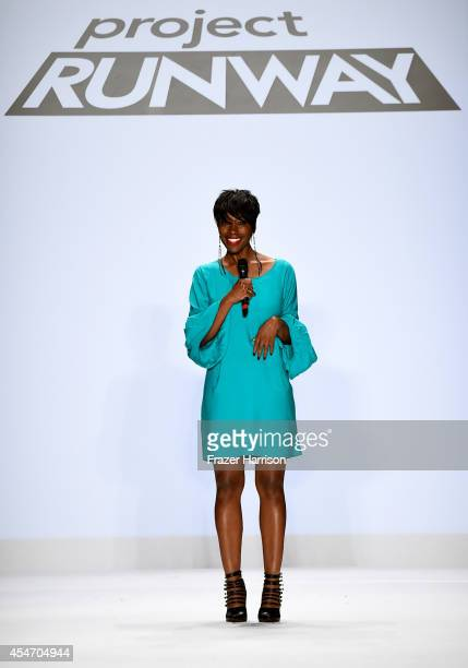 Designer Char Glover walks the runway at the Project Runway fashion show during MercedesBenz Fashion Week Spring 2015 at The Theatre at Lincoln...