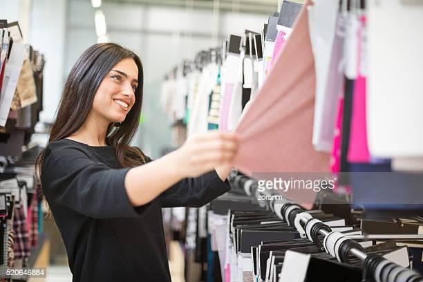 Designer choosing fabrics