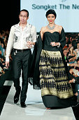 Designer Chossy Latu walks the catwalk following his collection show as part of LPM Graduates The Style Maker show on the fifth day of Jakarta...