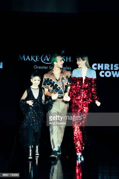 Designer Christian Cowan and Jaime King walk the runway during the fashion show at the PAPER Magazine Runway Benefit For MakeAWish Foundation at The...