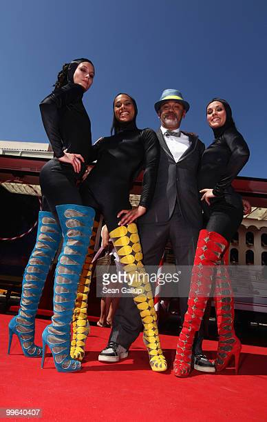 Designer Christian Louboutin and The Loubi's Angels attend 'Le Carrosse Noir And The Loubi's Angels' presented by Christian Louboutin at Palm Beach...