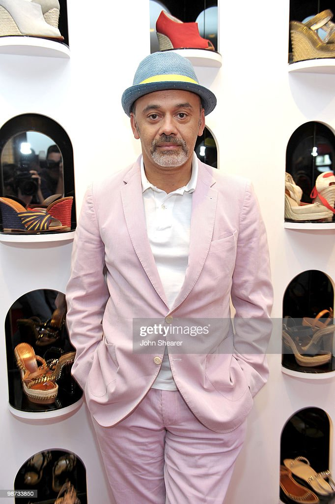 Designer Christian Louboutin poses for a photo at the Christian Louboutin Boutique on April 28 2010 in West Hollywood California