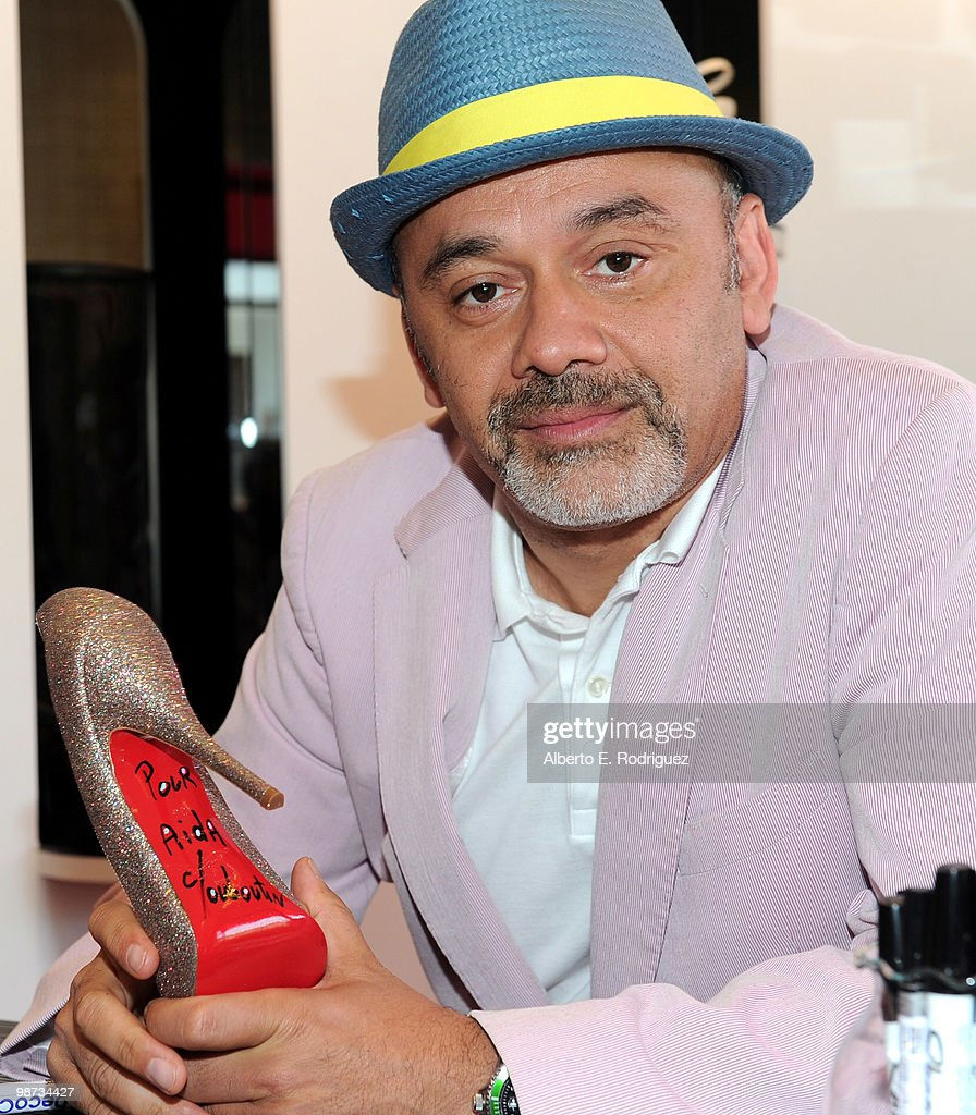 Designer Christian Louboutin poses for a photo at the grand opening of the new Christian Louboutin boutique on April 28 2010 in West Hollywood...