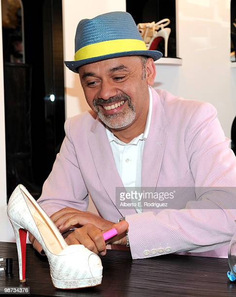 Designer Christian Louboutin signs an autograph at the grand opening of the new Christian Louboutin boutique on April 28 2010 in West Hollywood...
