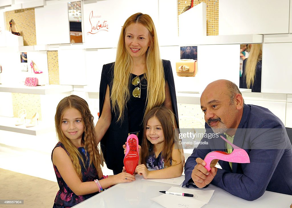 Designer Christian Louboutin spends time with customers at his personal appearance and shoe signing at Saks Fifth Avenue Beverly Hills on November 10, 2015 in Beverly Hills, California.
