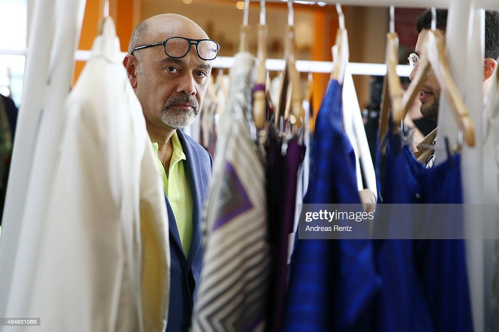Designer Christian Louboutin visits the Designer Showcase during the Vogue Fashion Dubai Experience 2015 at The Dubai Mall on October 30 2015 in...