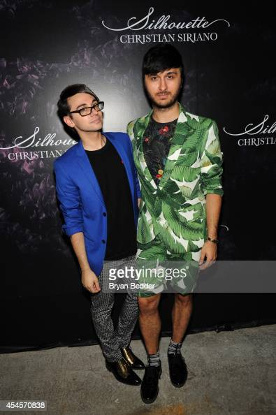 Designer Christian Siriano and Brad Walsh attend Christian Siriano's celebration of his new fragrance with a Stoli Vodka cocktail at the designer's...