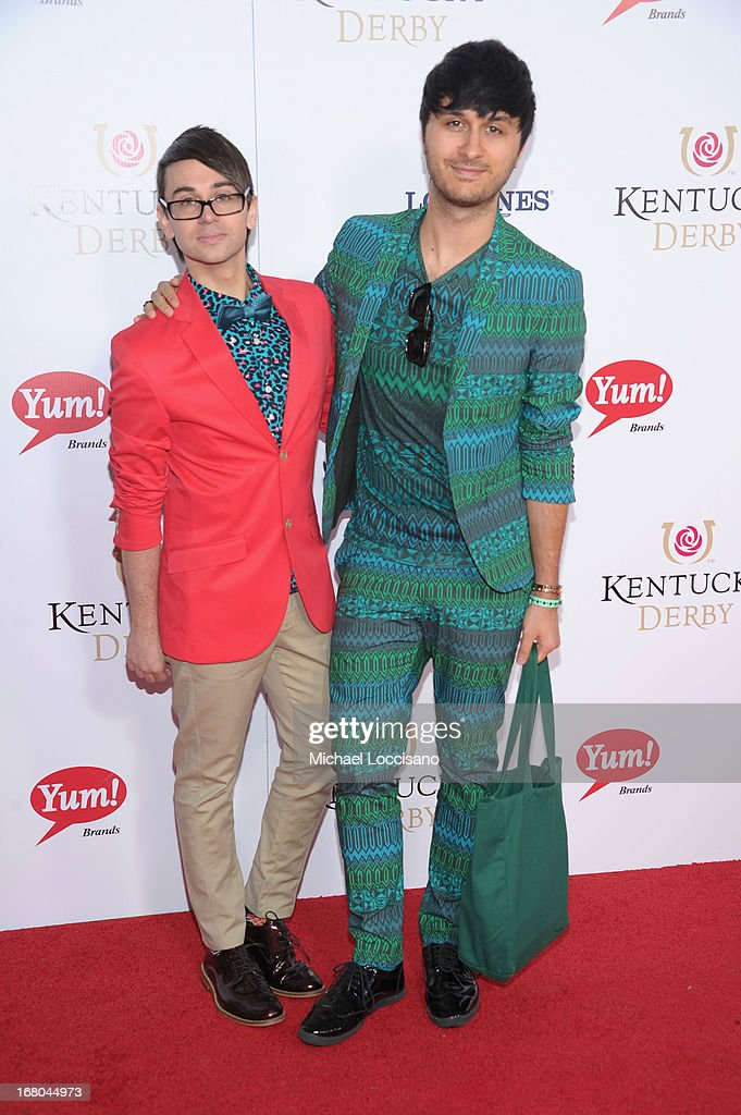 Designer Christian Siriano and Brad Walsh attend the 139th Kentucky Derby at Churchill Downs on May 4, 2013 in Louisville, Kentucky.