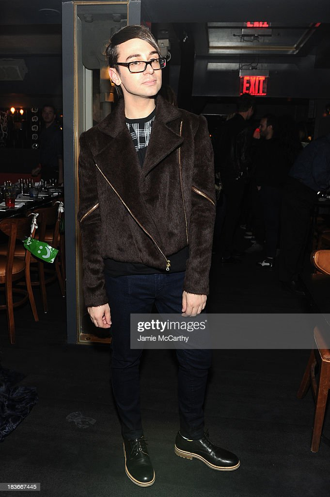Designer Christian Siriano attends NYLON + Sanuk celebrate the October 'It Girl' issue with cover star Alexa Chung at La Cenita on October 8, 2013 in New York City.