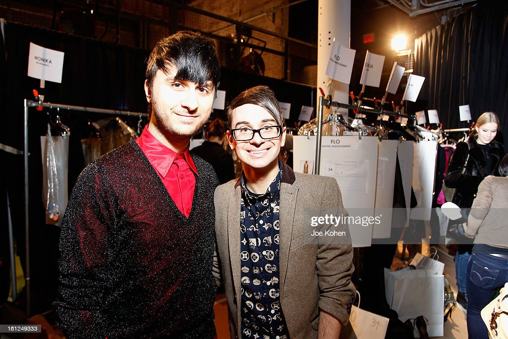 Designer Christian Siriano (R) poses backstage at the Christian Siriano Fall 2013 fashion show during Mercedes-Benz Fashion Week on February 9, 2013 in New York City.