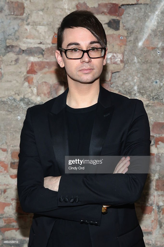 Designer Christian Siriano poses backstage at the Christian Siriano Fashion Show at ArtBeam on February 14 2015 in New York City