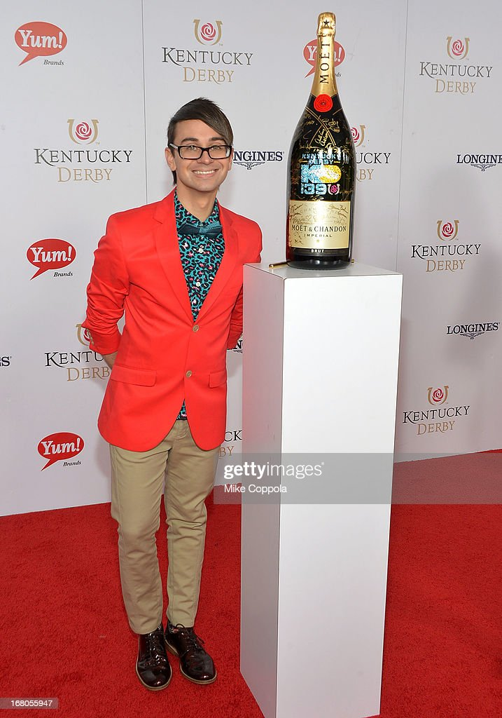 Designer Christian Siriano signs the Moet & Chandon 6L for the Churchill Downs Foundation during the 139th Kentucky Derby at Churchill Downs on May 4, 2013 in Louisville, Kentucky.